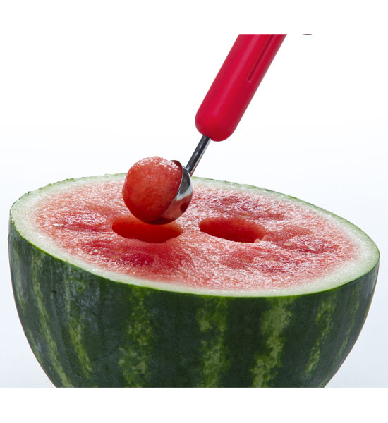 Watermelon with some flesh scooped out by a melon baller