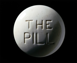 a round white pill that reads The Pill