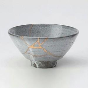 Broken tea bowl glued together with gold resin