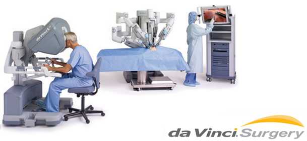 Doctor and assistant with da vinci robotic surgery equipment