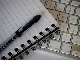 paper, pen, and keyboard