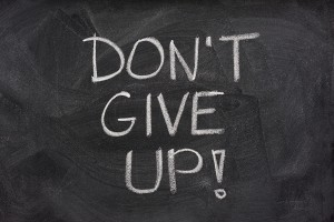 text on a chalkboard that reads Don't Give Up!