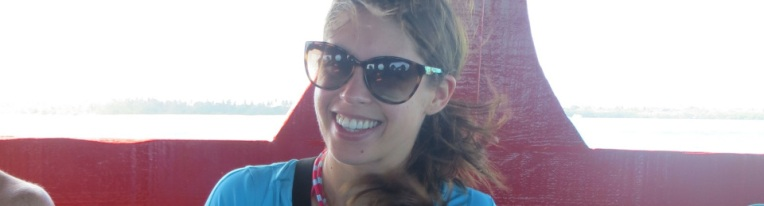 A woman with brown hair wearing sunglasses