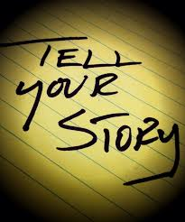 "Piece of paper that reads ""Tell Your Story"""