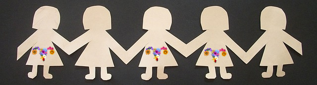 Paper dolls holding hands