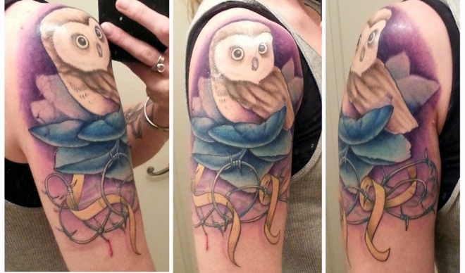 Tattoo with owl, blue lotus blossom, barbed wire, yellow ribbon, and blood