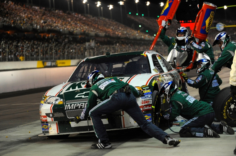 Pit crew working on a racecar