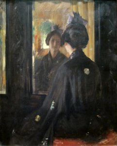 The Mirror by William Merritt Chase. A painting of a woman looking in the mirror in Victorian-era attire