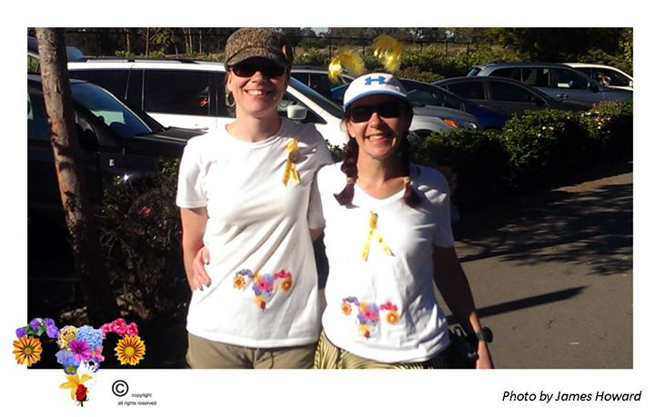 Two women wearing Bloomin' Uterus t-shirts