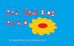 Real Neat Blog Award logo of a flower