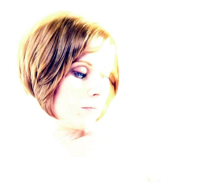 hi-key photo of a redhead with blue eyes