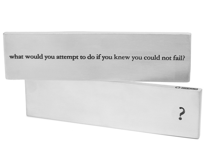 metal paperweight that reads what would you attempt to do if you knew you could not fail?