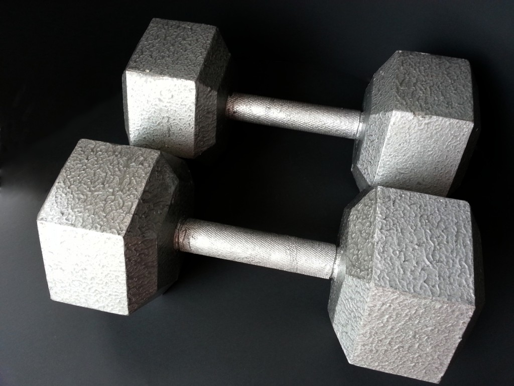 two iron dumbbells