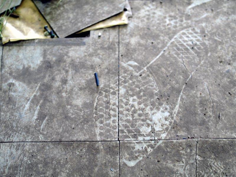 Footprint on a dirty floor