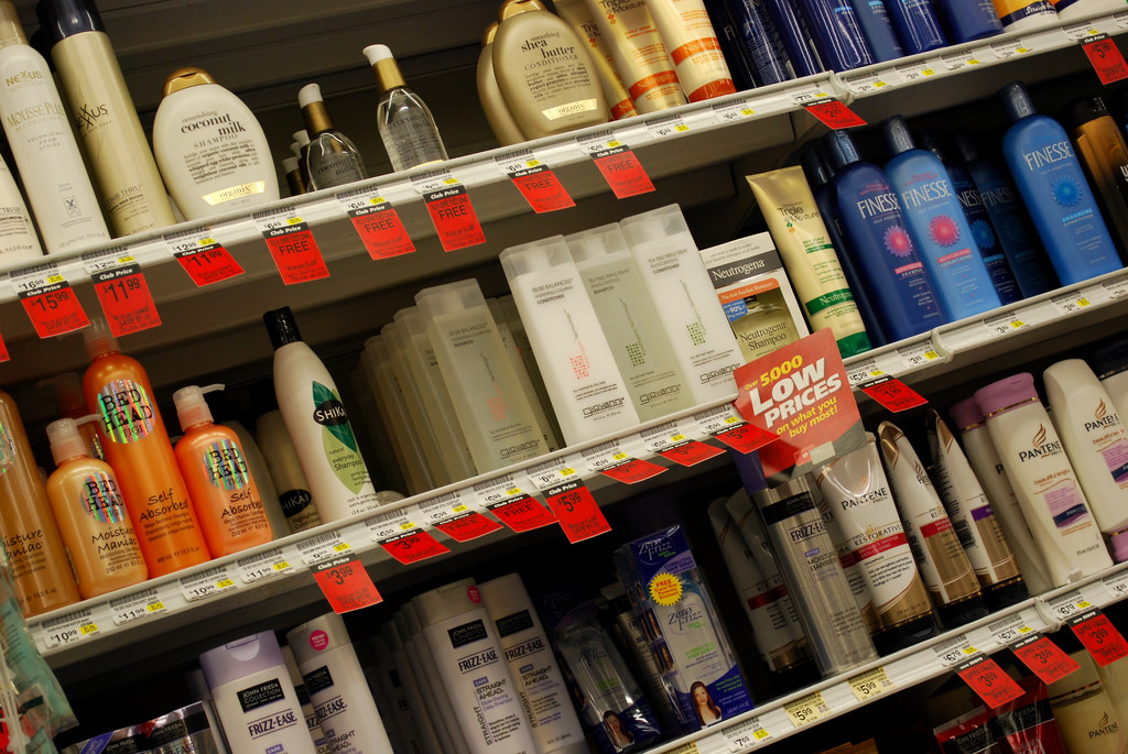Store shelves with shampoo bottles