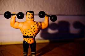 toy strongman lifting weights