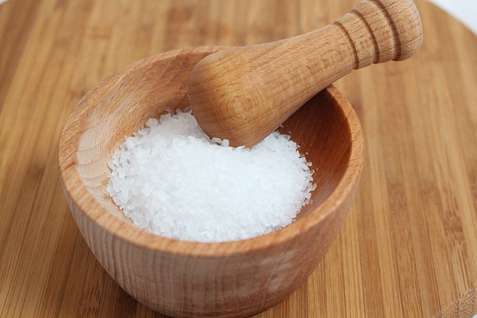 wooden mortar and pestle filled with salt