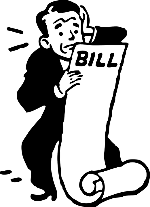 Worried man looking at a very large bill