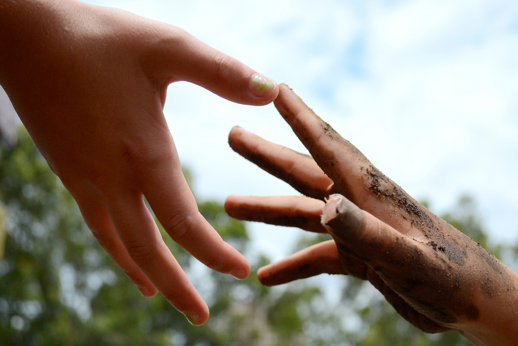 Two hands reaching out for each other