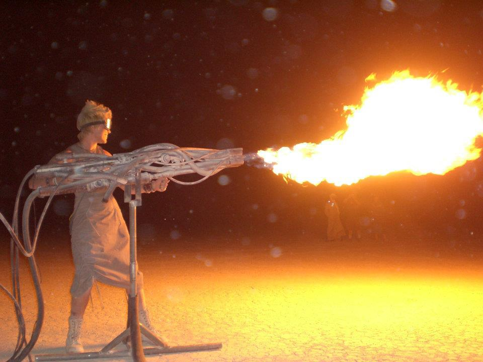 Girl with flame thrower at Burning Man
