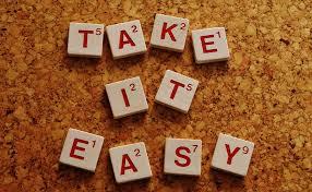 Scrabble tiles that spell Take It Easy