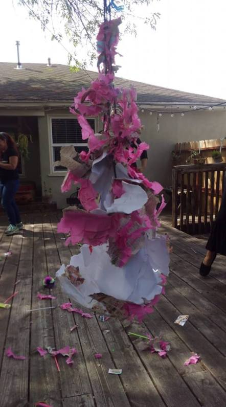 destroyed pinata that was in the shape of a uterus, now in tatters