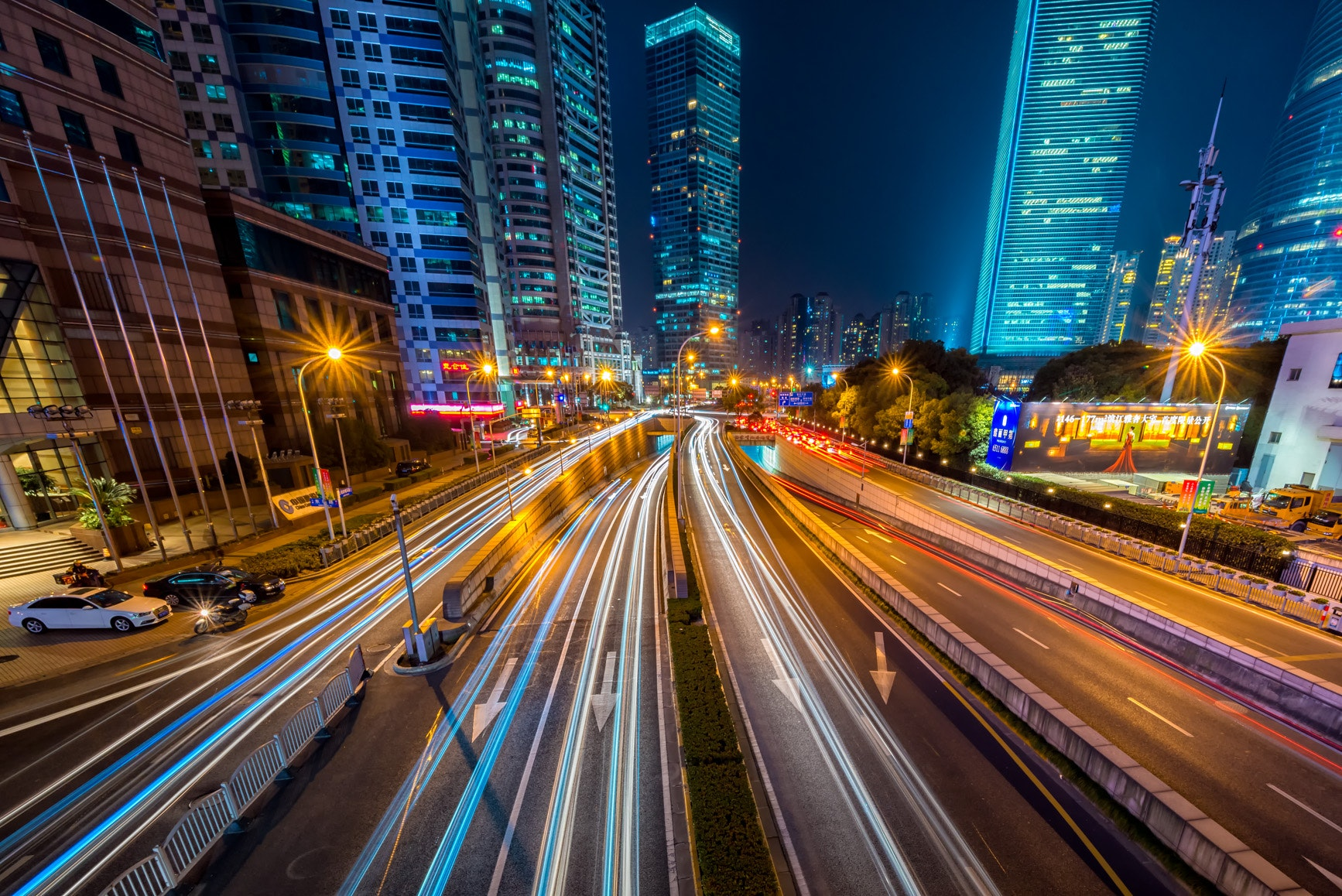Cityscape at night time with blurred lights of cars driving by