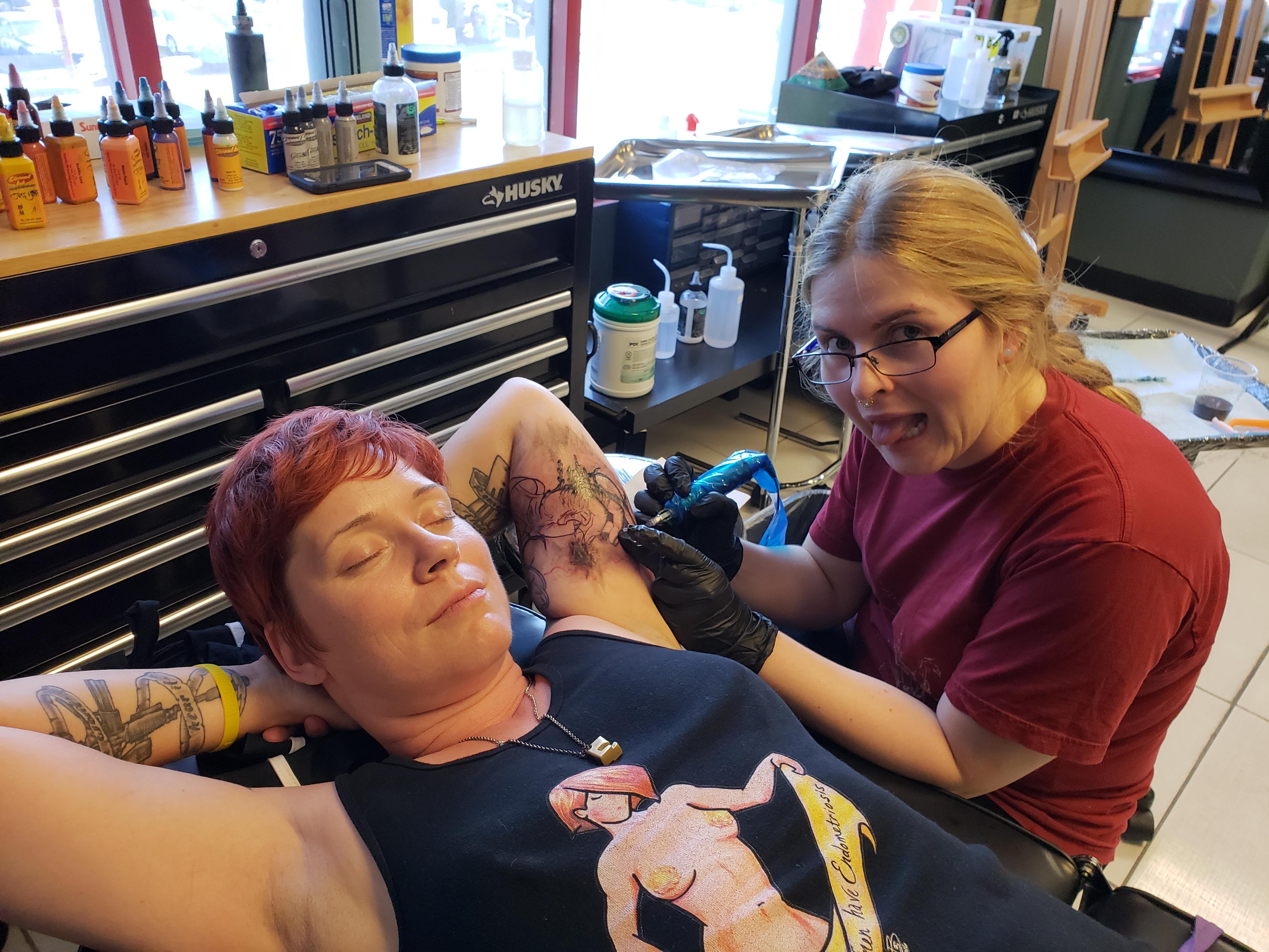 Mia tattooing my underarm