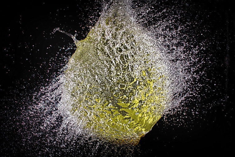 Yellow water balloon popping
