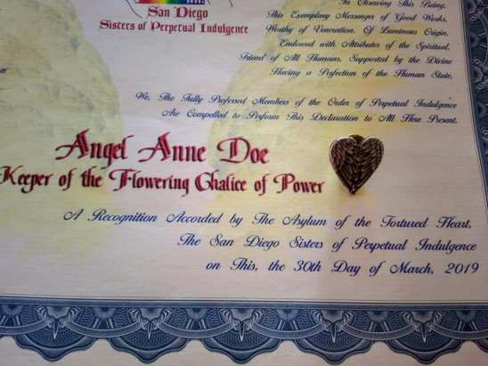 Certificate naming Angel Anne Doe, Keeper of the Flowering Chalice of Power
