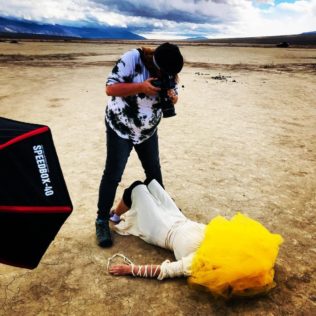 "Behind the Scenes: Brandy Sebastian shooting ""Endo Fog"" of an anonymous EndoWarrior on location in Death Valley.  Photo taken by photographer's mum and incredible assistant, Penny Kachuck"