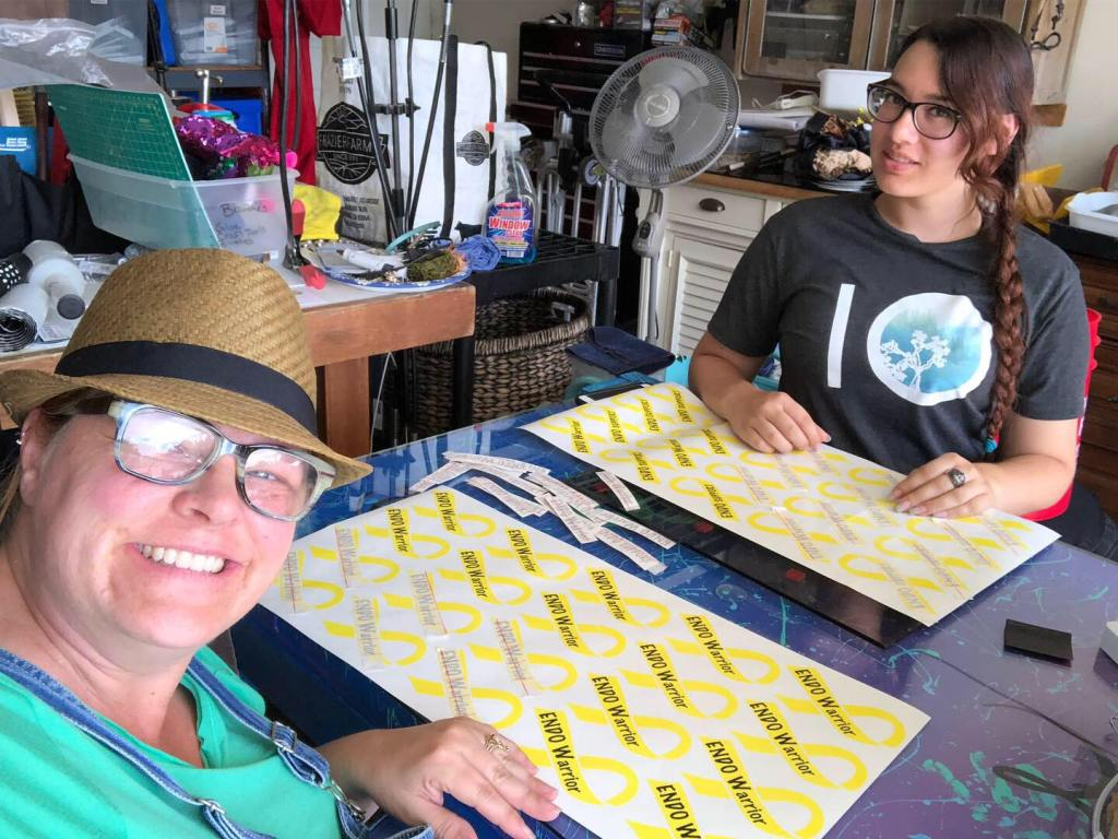 Brandy and Sam manufacturing the yellow ribbon EndoWarrior and EndoSupoprt decals