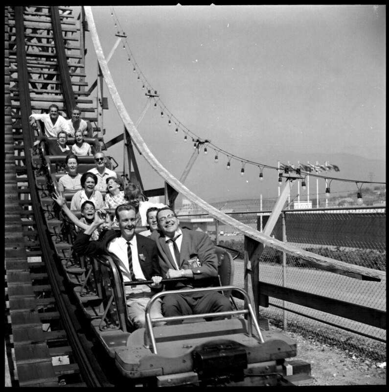 Photo of people riding a roller coaster, circa 1961