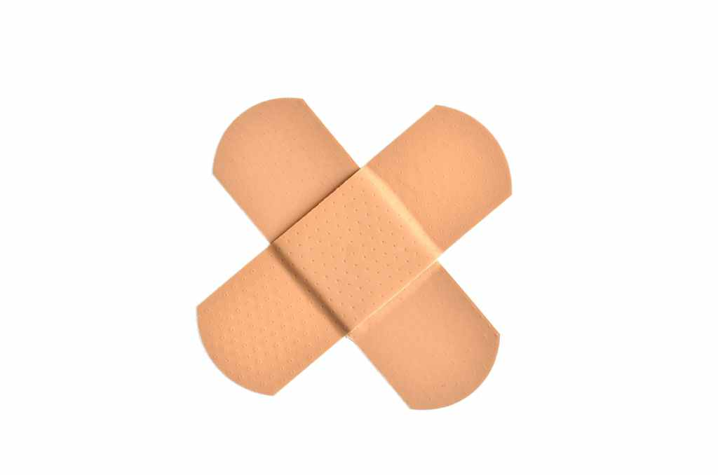 Bandaids crossing into an X