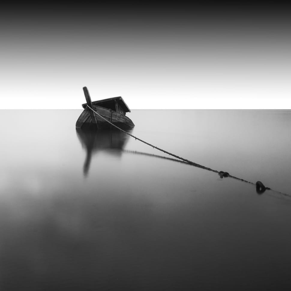 B&W phot of a sinking boat