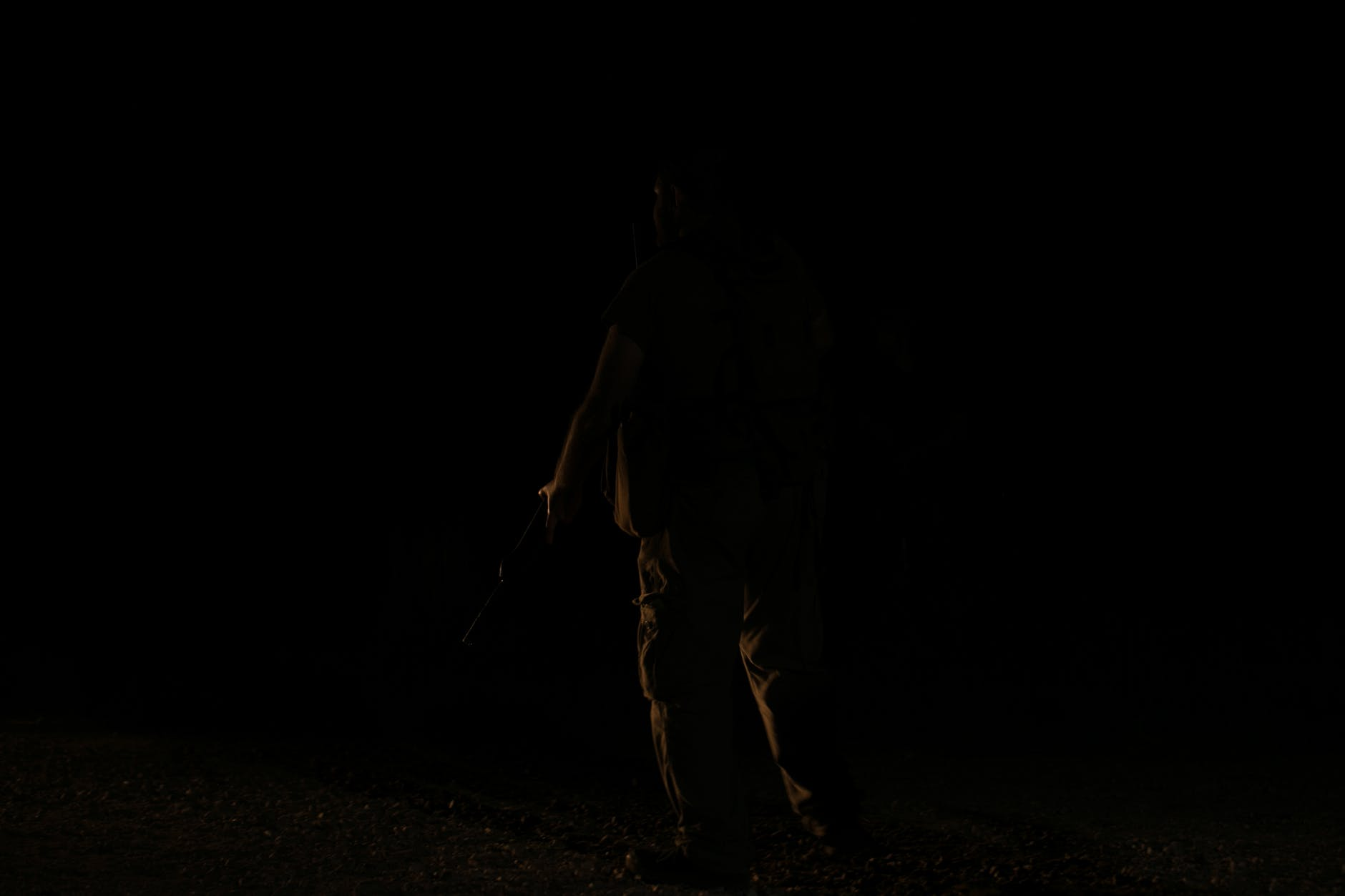Person standing in the darkness