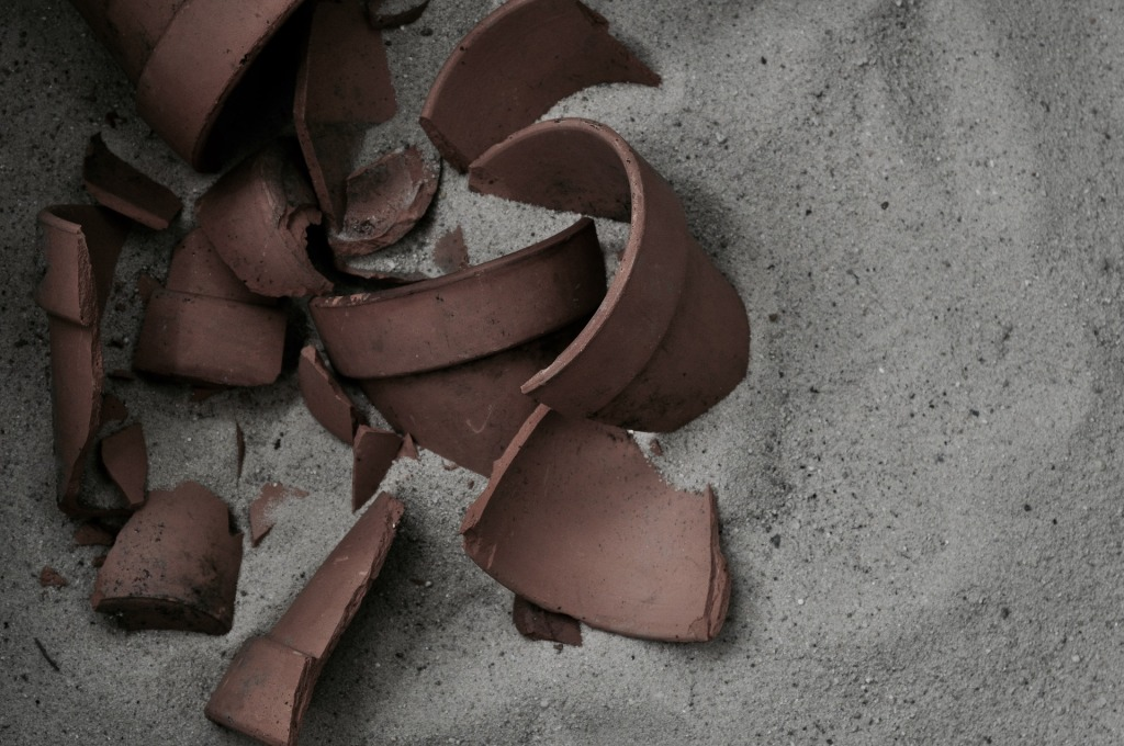 broken terracotta pot in the sand