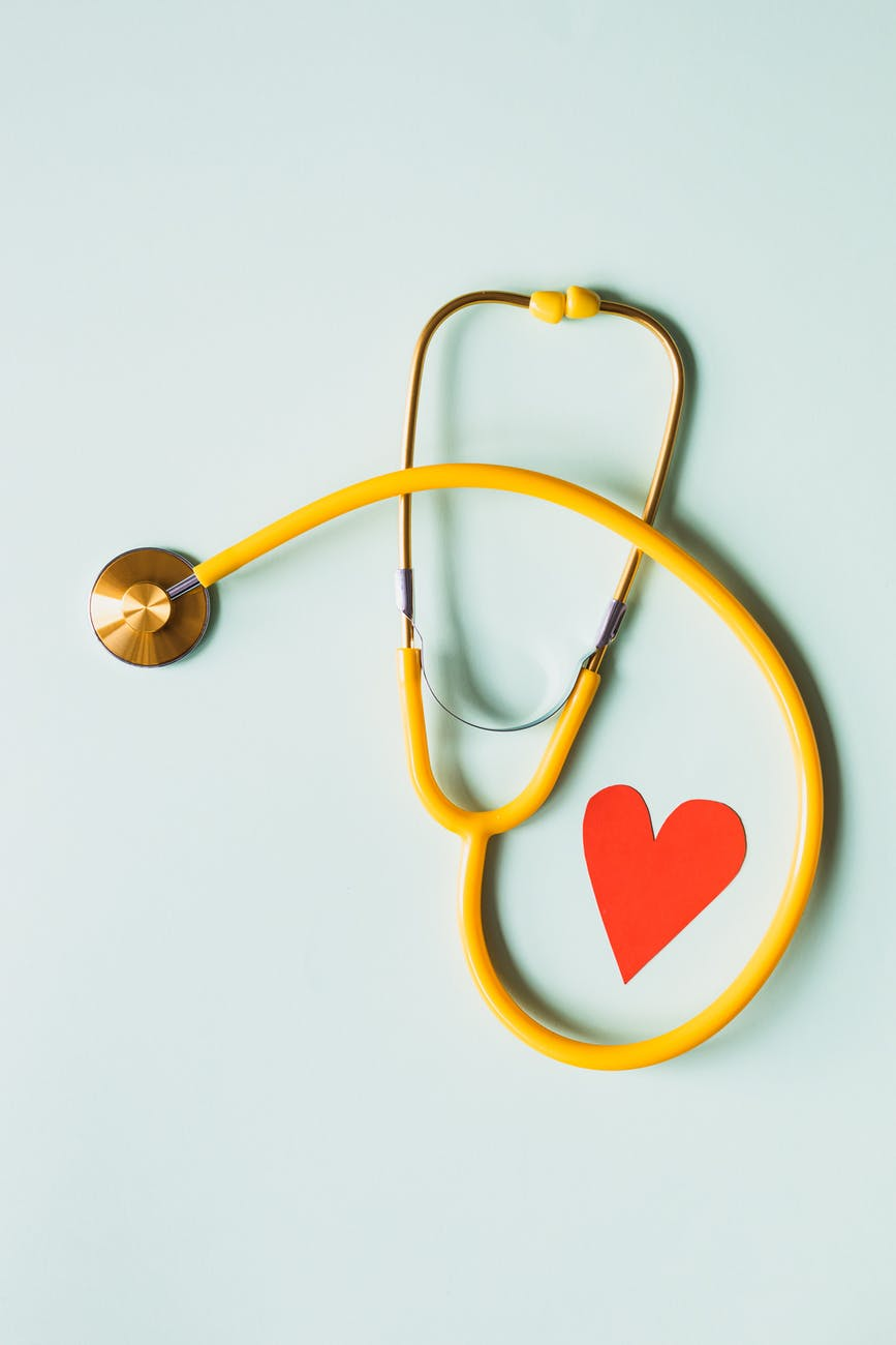 yellow stethoscope around a paper-cut-out heart