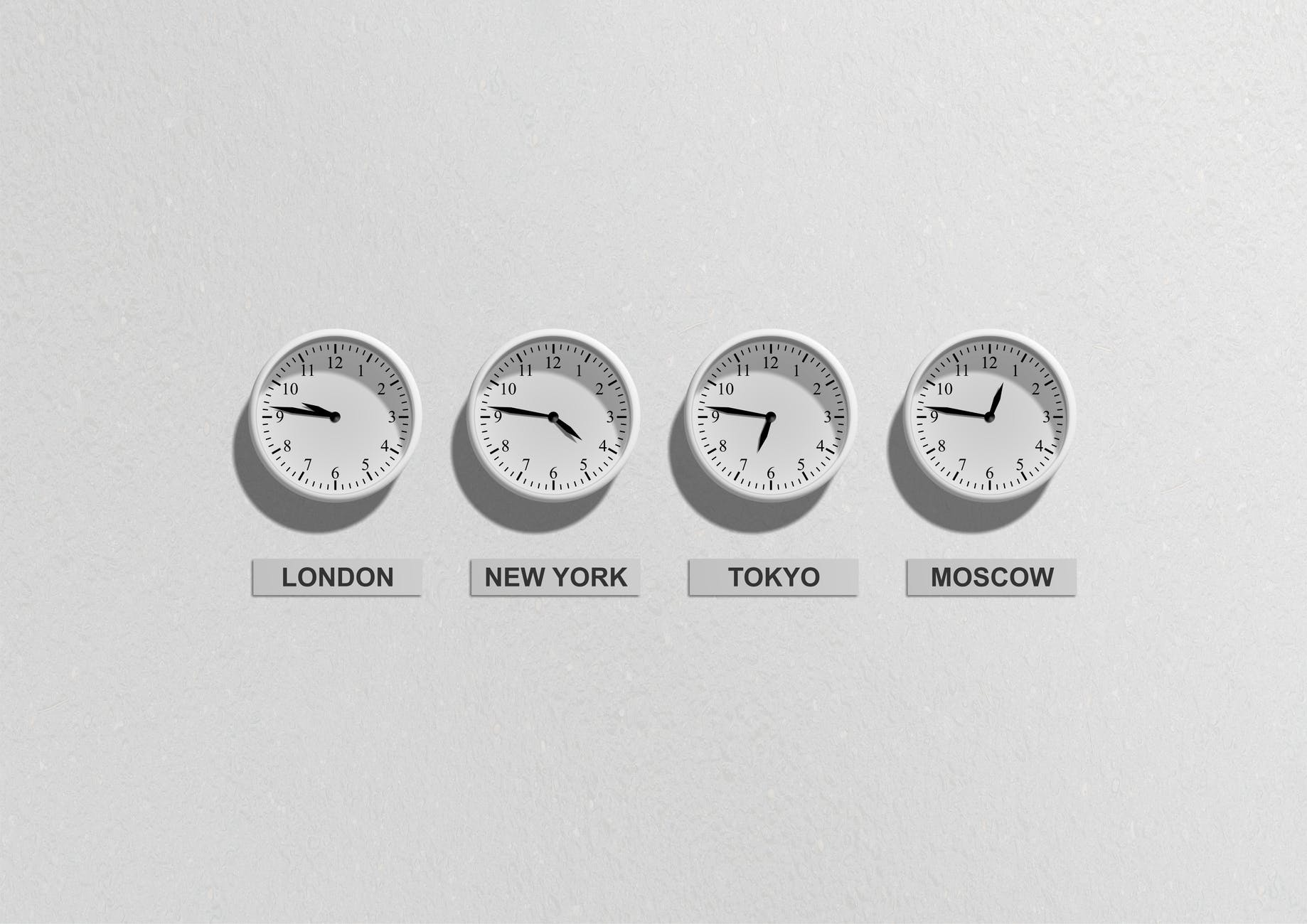 Clocks showing different times around the world