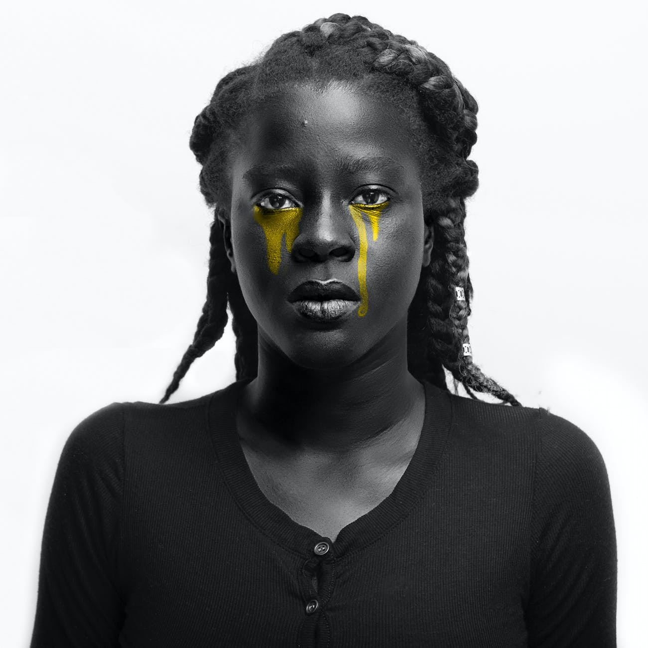woman crying yellow tears