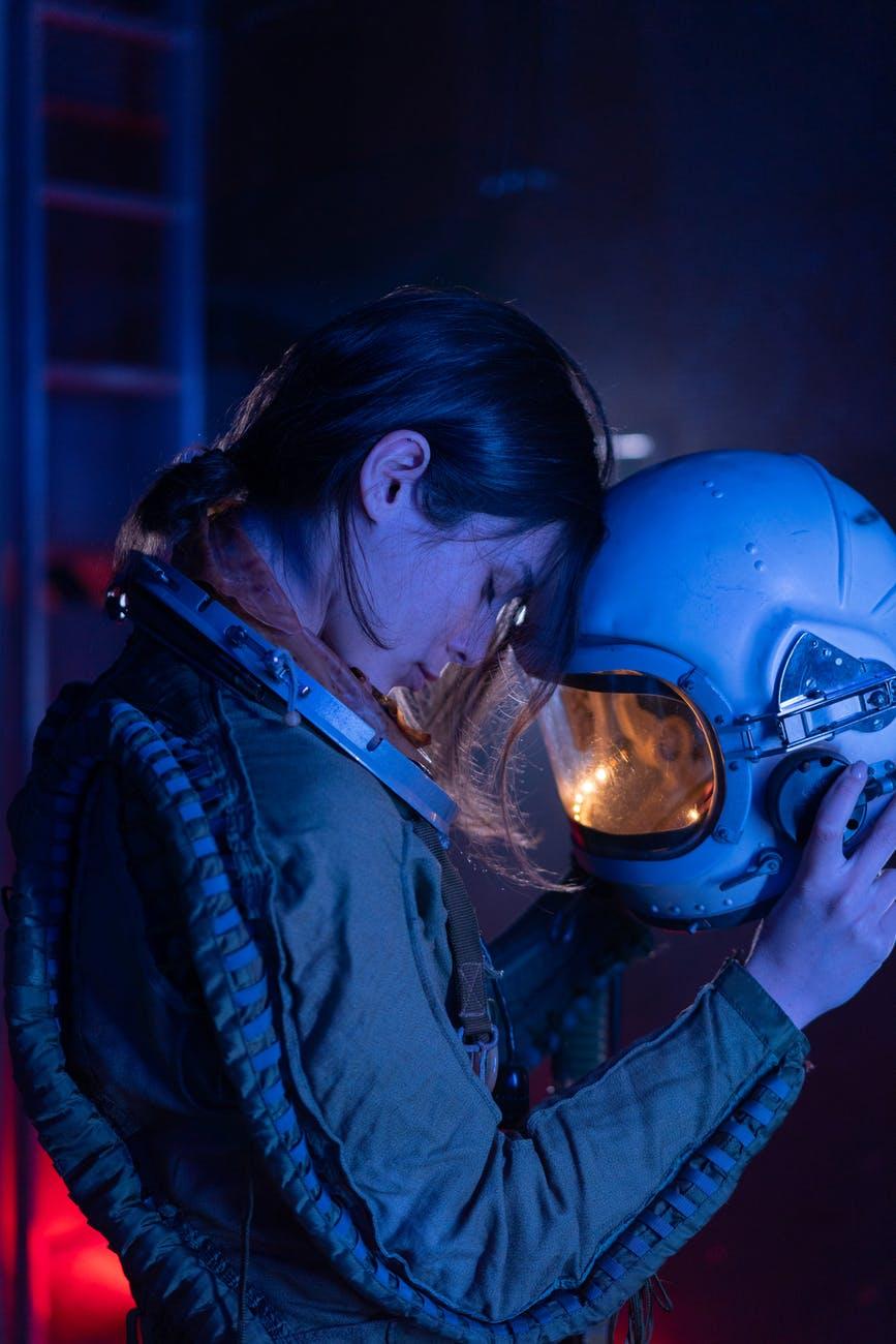 astronaut taking off helmet