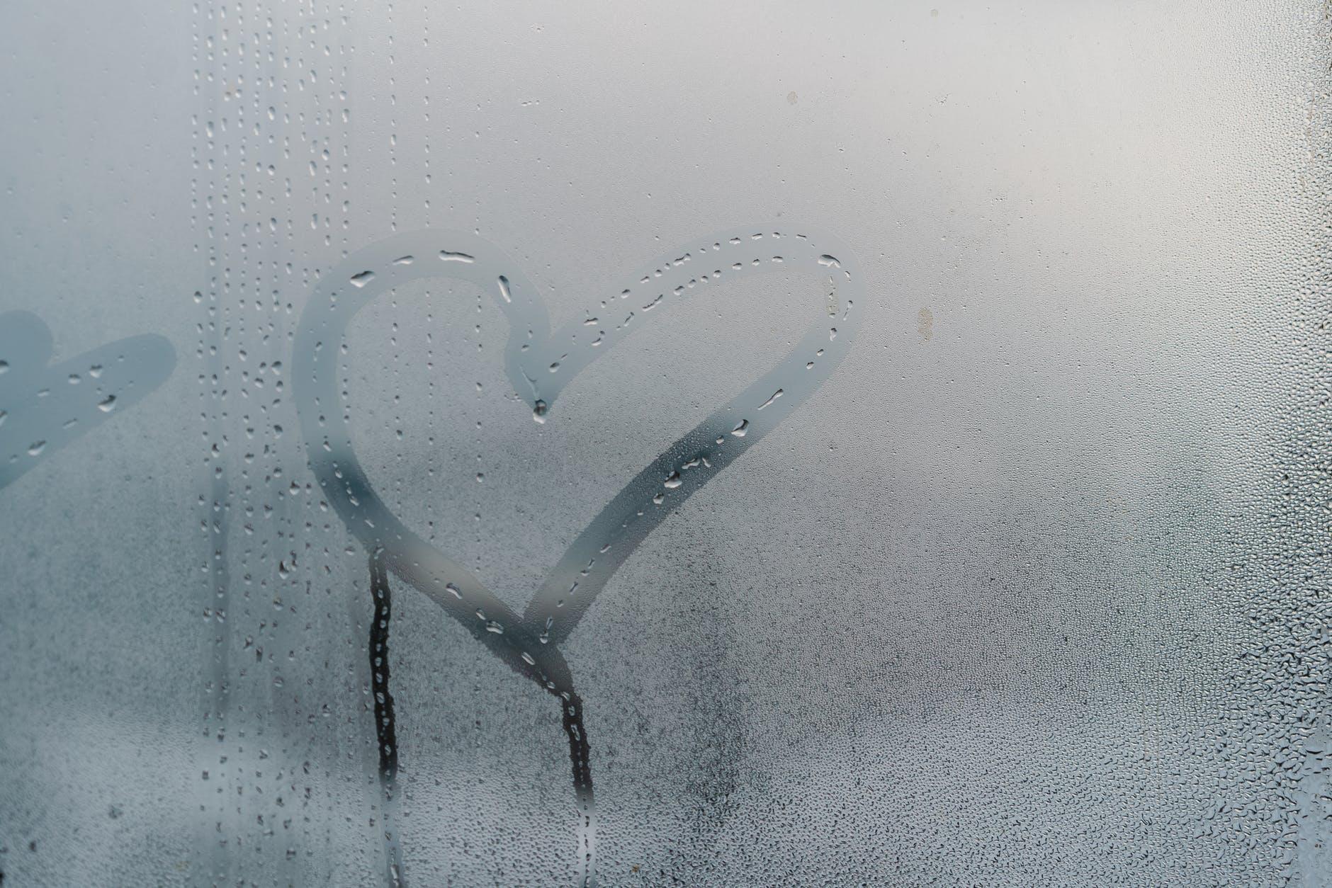 heart drawn into a steamy window
